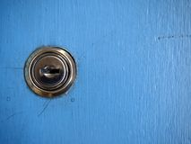 Keys and a keyhole on a blue door Stock Images