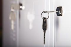 Keys in the keyhole closeup Stock Photos
