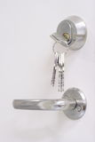 Keys, keyhole and doorhandle Stock Photography