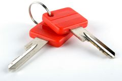 Keys on the keyring. Pair of keys  with red plastic heads on the keyring Royalty Free Stock Photography