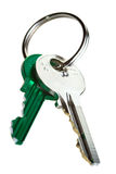 Keys on keyring. One green and one silver key on keyring Royalty Free Stock Photos