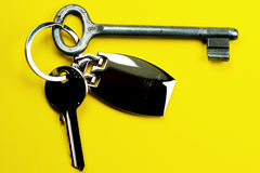 Keys and keyring. New and old key on yellow background isolated Stock Image