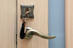 Keys left in a keyhole. Left the keys in the keyhole of the door Stock Photo