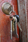 Keys in lock. Bunch of keys hanging from door lock Stock Photography