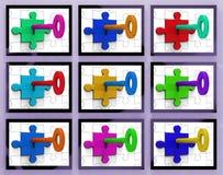 Keys In Locks On Monitors Showing Secrecy Royalty Free Stock Image