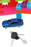 Keys, model car, plastic block house stock image