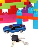 Keys, model car, plastic block house Royalty Free Stock Image