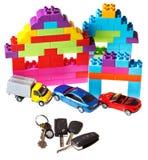 Keys, model car, plastic block house Stock Photo