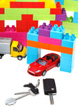 Keys, model car, plastic block house Stock Images