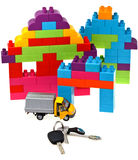 Keys, model car, plastic block house Royalty Free Stock Images