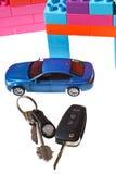Keys, model car, plastic block house Royalty Free Stock Photo