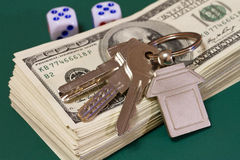 Keys money and rolling dice Stock Photo