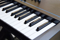 Keys of a music keyboard or piano. Macro of keys of a music keyboard or piano Royalty Free Stock Image