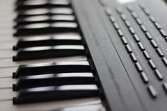 Keys of a musical keyboard synthesizer in black and white royalty free stock photos