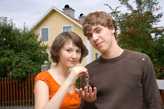 Keys of new house. Young happy couple with the keys of new house Stock Photography