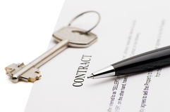 Keys of a new house and pen on contract. Royalty Free Stock Photography