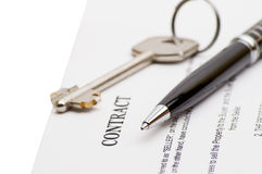 Keys of a new house and pen on contract. Royalty Free Stock Image