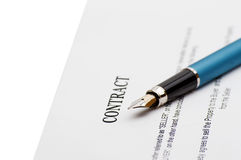 Keys of a new house and pen on contract. Stock Images