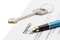 Keys of a new house and pen on contract. Royalty Free Stock Images