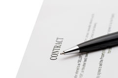 Keys of a new house and pen on contract. Royalty Free Stock Photo