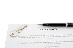 Keys of a new house and pen on contract. Royalty Free Stock Photos