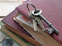Keys on old books. Keys on book stack royalty free stock photos