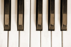 Keys of an old piano. In sepia Royalty Free Stock Photos