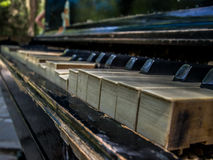 The keys of old piano. Old piano is standing in park of Simferopol, Crimea Stock Images