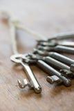 Keys. Old keys on wooden background Royalty Free Stock Photos