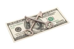 Keys and one hundred dollars Royalty Free Stock Images