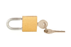 Keys in open padlock. Set of two keys with one in open padlock, isolated on white background Stock Photo