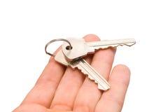 Keys on a palm Stock Photos