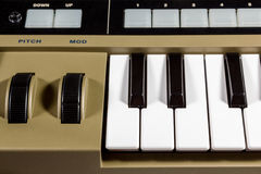 Keys piano synthesizer. Fragment electric music synthesizer with a set of buttons Royalty Free Stock Photo
