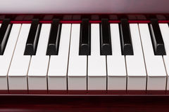 Keys of red piano Stock Photos