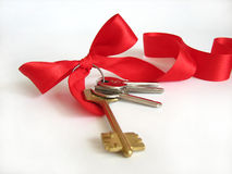 Keys with red ribbon Stock Photography