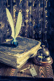 Keys for rooms and guestbook in vintage reception in hotel Stock Images
