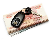 Keys of second-hand car and money. Keys of second-hand car and russian money Royalty Free Stock Photo