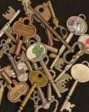 Keys. Several unique long brass keys against black background Stock Photography