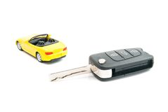 Keys and sport car on white Stock Images