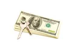 Keys and stack of dollars Royalty Free Stock Photography
