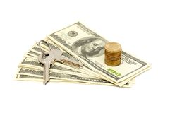 Keys and stack of dollars Stock Image