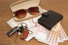Keys and sunglasses on a road map with pocket money,Ready to tr Royalty Free Stock Image