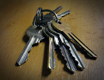 Keys on the table. Scratched old keys on the table stock image