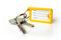 Keys with tag. Two door keys wit identification tag isolated in white background Royalty Free Stock Photos