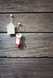 Keys with a tag. On wooden background Royalty Free Stock Photography