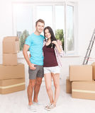 Keys of their new house. Cheerful young couple holding key. Royalty Free Stock Photos