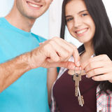 Keys of their new house. Cheerful young couple holding key. Stock Photos