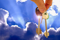 The keys to the apartment on the background of blue sky and clouds . The concept of new home sales royalty free stock photography