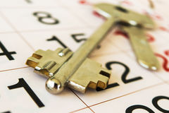 The keys to the apartment, and calendar. stock images