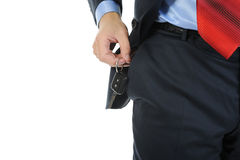 Keys to the car. Image of a businessman gets the keys to the car out of pocket. Isolated on white Royalty Free Stock Image